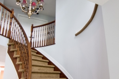 A stairwell painted in Benjamin Moore Gray Cloud