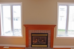 A living room fireplace wall painted by Precision Painting in Ottawa